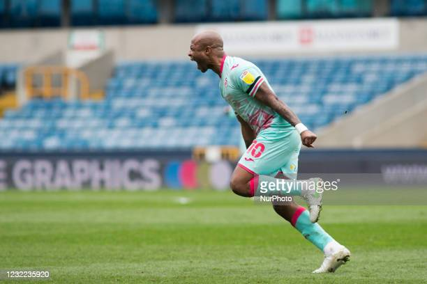 Andre Ayew of Swansea City celebrates after scoring during the Sky Bet Championship match between Millwall and Swansea City at The Den, London,...