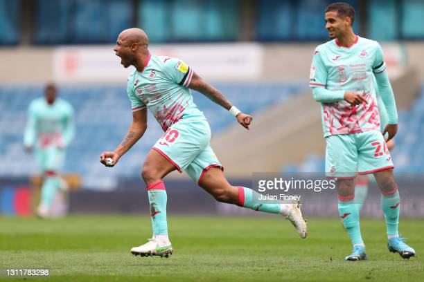 Andre Ayew of Swansea City celebrates after scoring their team's first goal during the Sky Bet Championship match between Millwall and Swansea City...