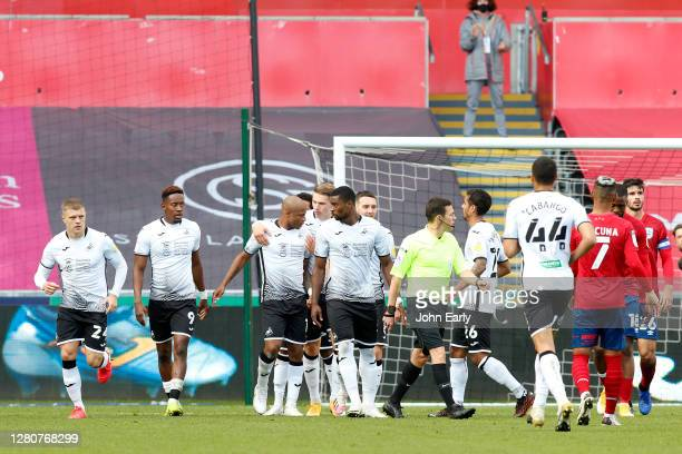 Andre Ayew of Swansea City celebrates his goal with his teammates during the Sky Bet Championship match between Swansea City and Huddersfield Town at...