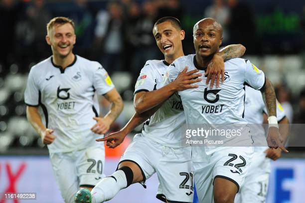 Andre Ayew of Swansea City celebrates scoring his side's equalising goal to make the score 11 during the Carabao Cup First Round match between...