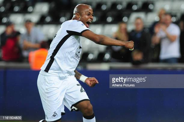 Andre Ayew of Swansea City celebrates scoring his side's third goal during the Carabao Cup First Round match between Swansea City and Northampton...