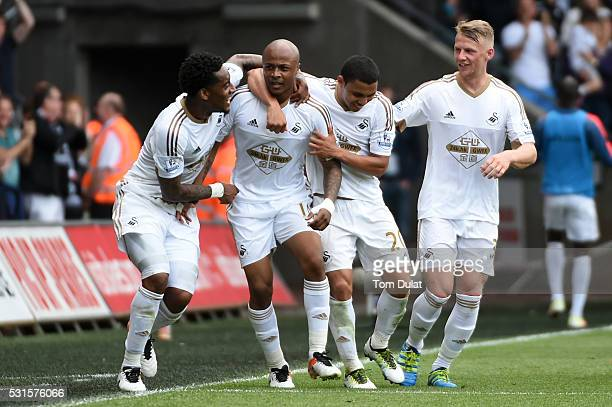 Andre Ayew of Swansea City celebrates scoring his team's first goal with his team mates during the Barclays Premier League match between Swansea City...