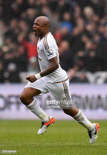 Andre Ayew of Swansea City celebrates scoring his team's third goal during the Barclays Premier League match between Swansea City and Liverpool at...