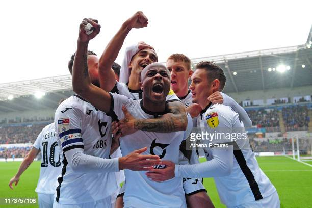 Andre Ayew of Swansea City celebrates scoring the opening goal during the Sky Bet Championship match between Swansea City and Stoke City at the...