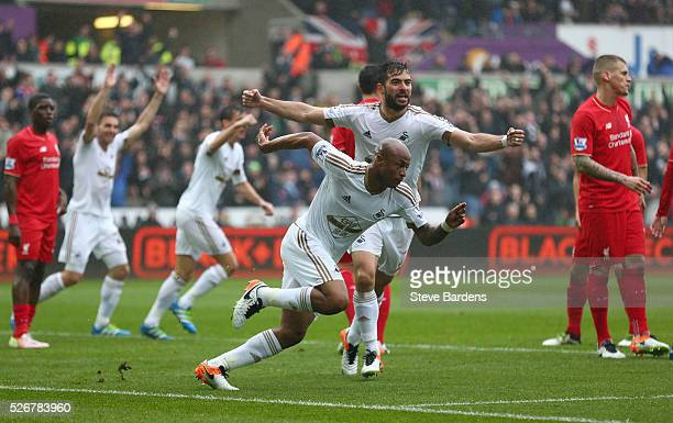 Andre Ayew of Swansea City celebrates scoring the opening goal during the Barclays Premier League match between Swansea City and Liverpool at The...