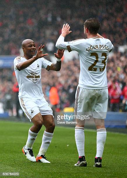 Andre Ayew of Swansea City celebrates scoring the opening goal with Gylfi Sigurdsson during the Barclays Premier League match between Swansea City...