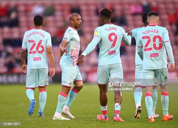 Andre Ayew of Swansea City celebrates with Jamal Lowe after scoring his team's first goal during the Sky Bet Championship Play-off Semi Final 1st Leg...