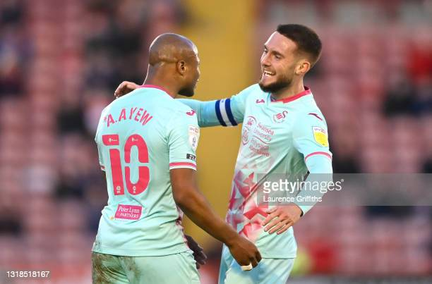 Andre Ayew of Swansea City celebrates with Matt Grimes after scoring his team's first goal during the Sky Bet Championship Play-off Semi Final 1st...