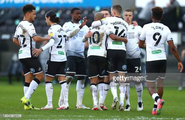 Andre Ayew of Swansea City celebrates with team mates after scoring their side's first goal from the penalty spot during the Sky Bet Championship...