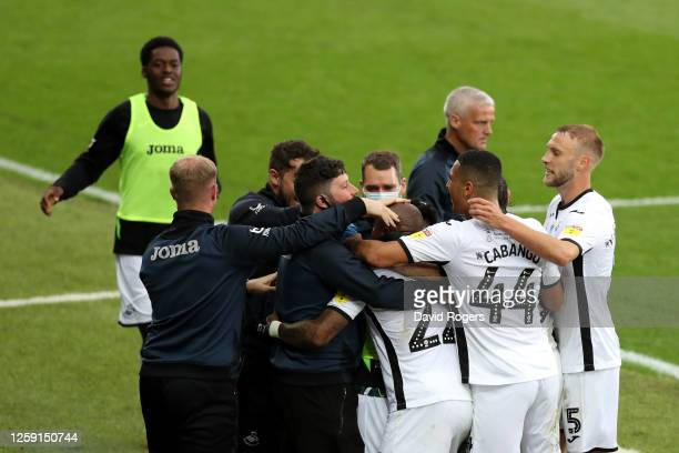 Andre Ayew of Swansea City celebrates with teammates and staff after scoring his team's first goal during the Sky Bet Championship Play Off Semifinal...