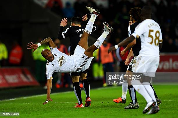 Andre Ayew of Swansea City clashes with Jose Manuel Jurado of Watford during the Barclays Premier League match between Swansea City and Watford at...