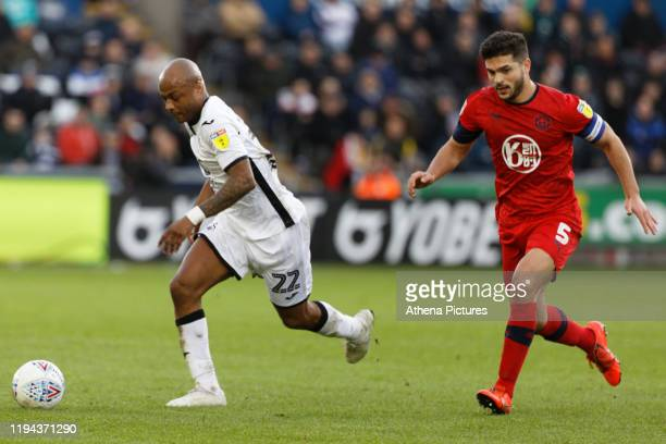 Andre Ayew of Swansea City controls the ball against Sam Morsy of Wigan Athletic during the Sky Bet Championship match between Swansea City and Wigan...