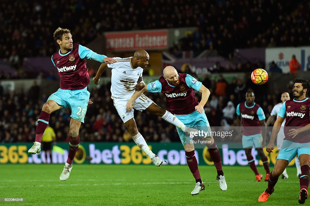 Andre Ayew of Swansea City directs a header towards the West Ham goal during the Barclays Premier League match between Swansea City and West Ham United at the Liberty Stadium on December 20, 2015 in Swansea, Wales.