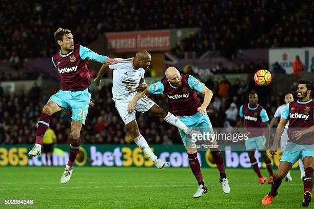 Andre Ayew of Swansea City directs a header towards the West Ham goal during the Barclays Premier League match between Swansea City and West Ham...