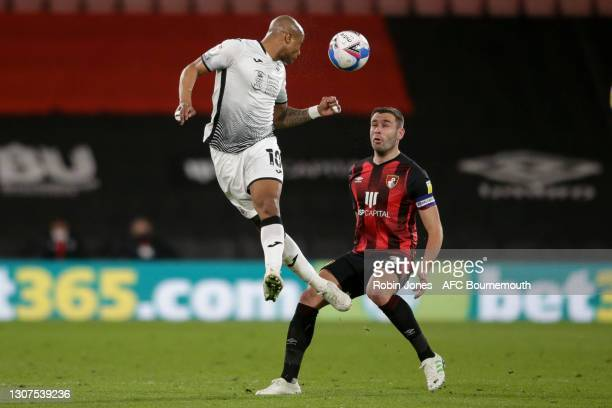 Andre Ayew of Swansea City heads past Steve Cook of Bournemouth during the Sky Bet Championship match between AFC Bournemouth and Swansea City at...