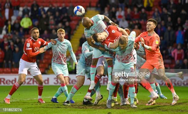 Andre Ayew of Swansea City heads the ball clear during the Sky Bet Championship Play-off Semi Final 1st Leg match between Barnsley and Swansea City...