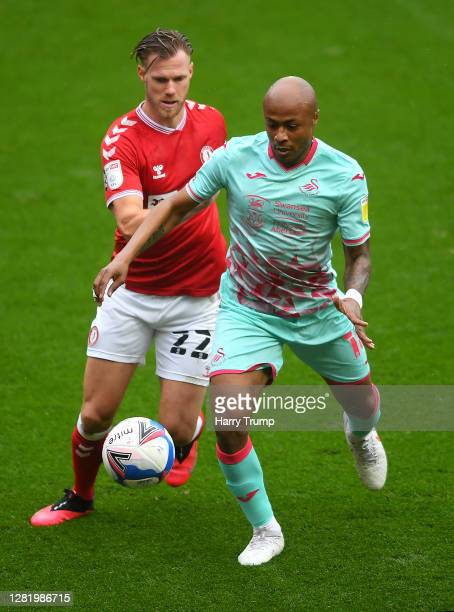 Andre Ayew of Swansea City is challenged by Tomas Kalas of Bristol City during the Sky Bet Championship match between Bristol City and Swansea City...