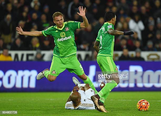 Andre Ayew of Swansea City is fouled by Wes Brown of Sunderland in the area resutling in a penalty during the Barclays Premier League match between...