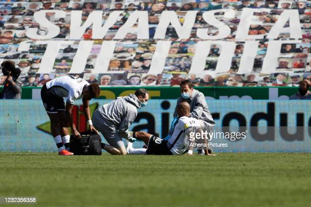 Andre Ayew of Swansea City is injured on the ground during the Sky Bet Championship match Swansea City and Wycombe Wanderers at Liberty Stadium on...