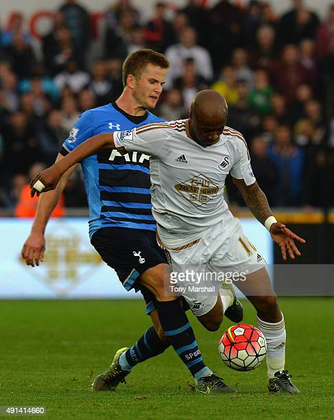 Andre Ayew of Swansea City is tackled by Eric Dier of Tottenham Hotspur during the Barclays Premier League match between Swansea City and Tottenham...