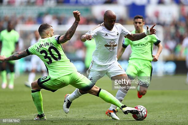 Andre Ayew of Swansea City is tackled by Nicolas Otamendi of Manchester City during the Barclays Premier League match between Swansea City and...