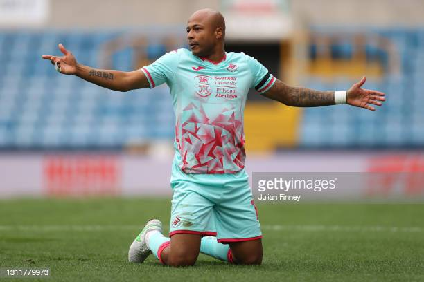 Andre Ayew of Swansea City reacts after a challenge during the Sky Bet Championship match between Millwall and Swansea City at The Den on April 10,...