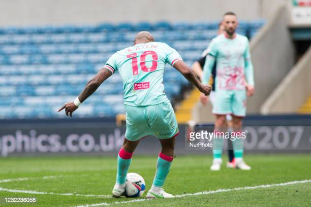 Andre Ayew of Swansea City scores during the Sky Bet Championship match between Millwall and Swansea City at The Den, London, England on 10th April...