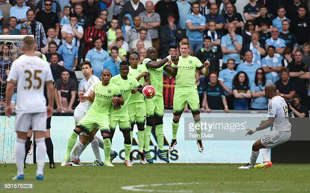 Andre Ayew of Swansea City scores his team's first goal from a free kick during the Barclays Premier League match between Swansea City and Manchester...