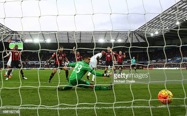 Andre Ayew of Swansea City scores his team's first goal past Adam Federici of Bournemouth during the Barclays Premier League match between Swansea...