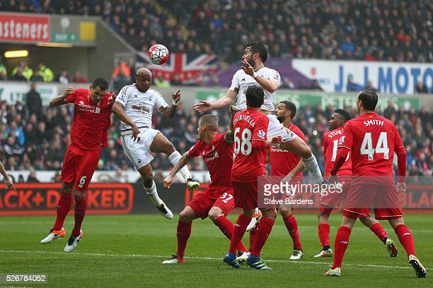 Andre Ayew of Swansea City scores the opening goal with a header during the Barclays Premier League match between Swansea City and Liverpool at The...