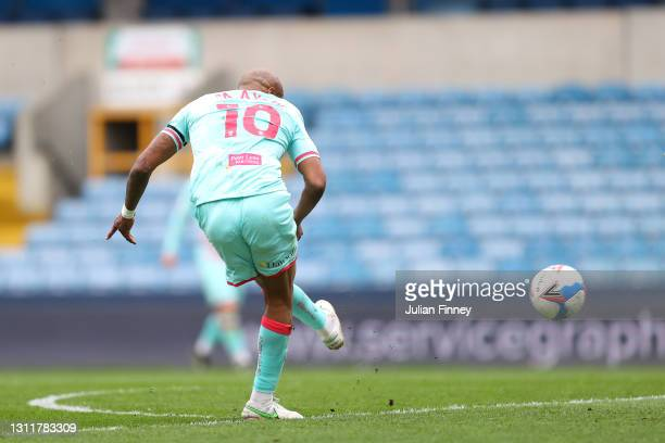 Andre Ayew of Swansea City scores their team's first goal during the Sky Bet Championship match between Millwall and Swansea City at The Den on April...