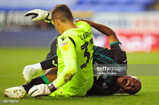 Andre Ayew of Swansea City screams in pain as he collides with Rafael of Reading during the Sky Bet Championship match between Reading and Swansea...