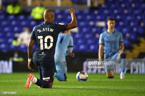 Andre Ayew of Swansea City takes a knee in support of the Black Lives Matter movement prior to the Sky Bet Championship match between Coventry City...