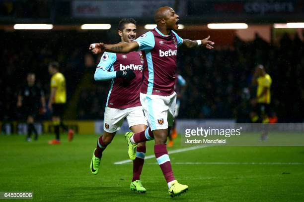 Andre Ayew of West Ham United celebrates after scoring his sides first goal during the Premier League match between Watford and West Ham United at...