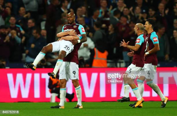 Andre Ayew of West Ham United celebrates as he scores their second goal during the Premier League match between West Ham United and Huddersfield Town...