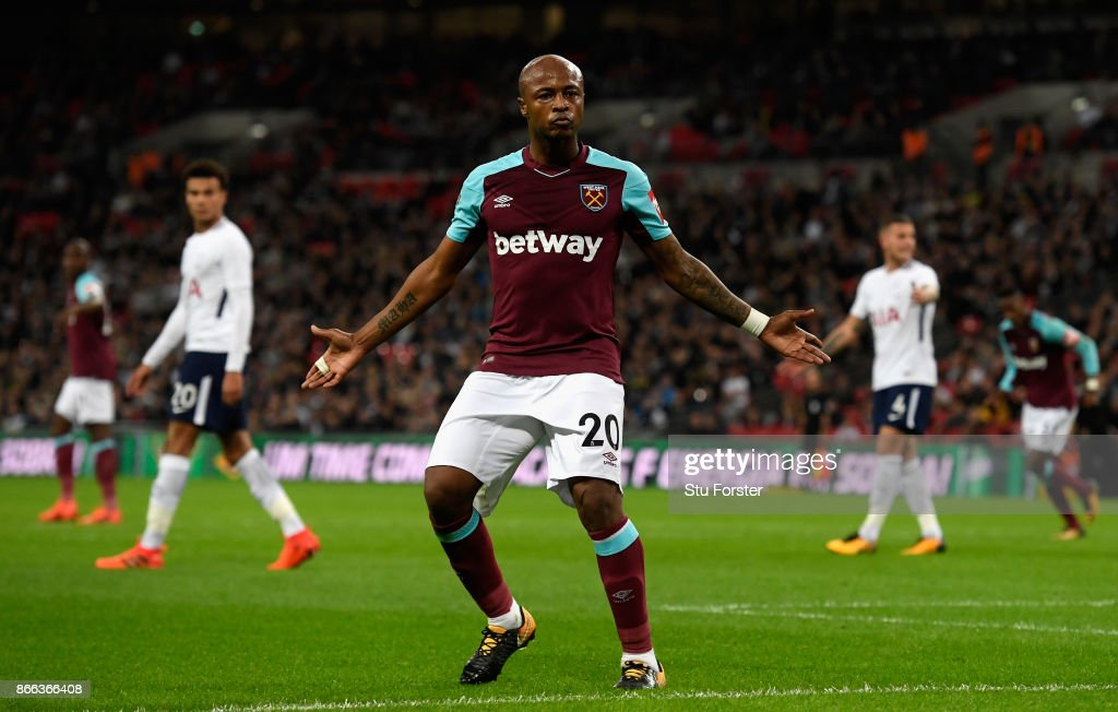 Andre Ayew of West Ham United celebrates scoring his side's first goal during the Carabao Cup Fourth Round match between Tottenham Hotspur and West Ham United at Wembley Stadium on October 25, 2017 in London, England.