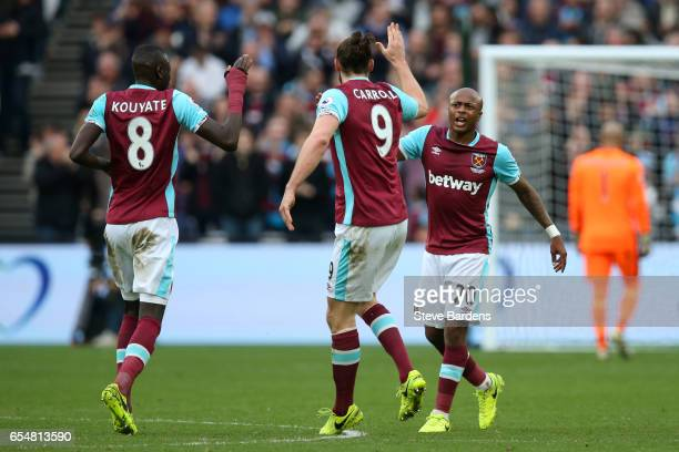 Andre Ayew of West Ham United celebrates scoring his sides second goal with Cheikhou Kouyate of West Ham United and Andy Carroll of West Ham United...