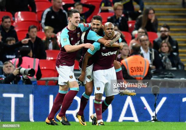 Andre Ayew of West Ham United celebrates scoring his side's second goal with team mates during the Carabao Cup Fourth Round match between Tottenham...