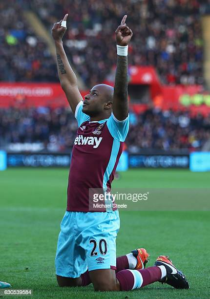 Andre Ayew of West Ham United celebrates scoring the opening goal during the Premier League match between Swansea City and West Ham United at Liberty...