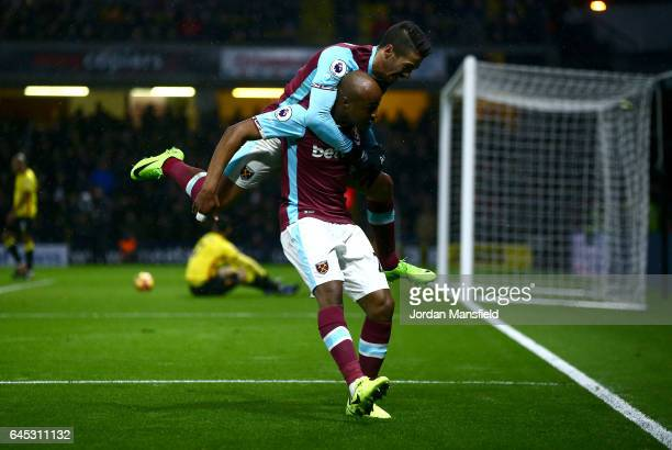 Andre Ayew of West Ham United celebrates with Manuel Lanzini of West Ham United after scoring his sides first goal during the Premier League match...