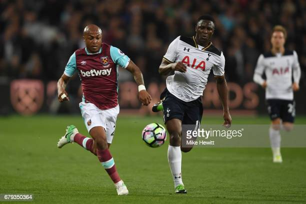 Andre Ayew of West Ham United is pursued by Victor Wanyama of Tottenham Hotspur during the Premier League match between West Ham United and Tottenham...