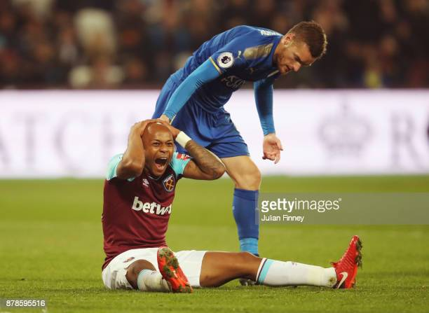Andre Ayew of West Ham United reacts as Jamie Vardy of Leicester City looks on during the Premier League match between West Ham United and Leicester...