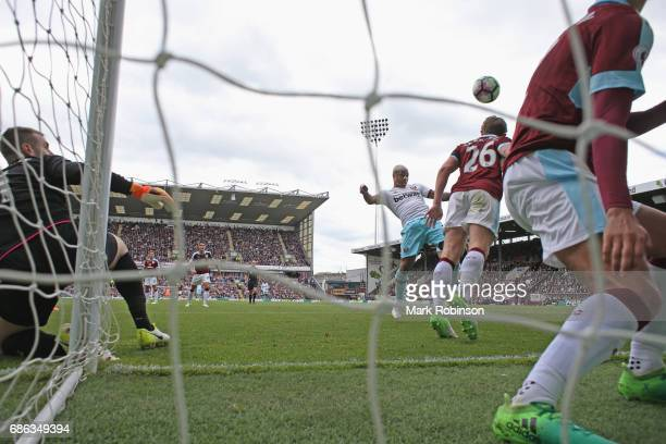 Andre Ayew of West Ham United scores his sides second goal during the Premier League match between Burnley and West Ham United at Turf Moor on May 21...
