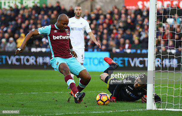Andre Ayew of West Ham United scores the opening goal during the Premier League match between Swansea City and West Ham United at Liberty Stadium on...