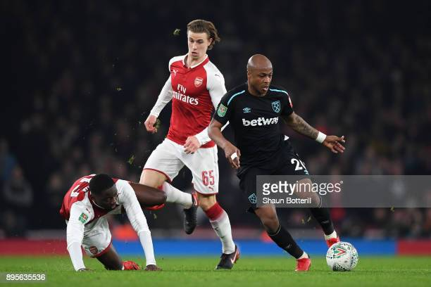 Andre Ayew of West Ham United takes on Josh Da Silva and Ben Sheaf of Arsenal during the Carabao Cup QuarterFinal match between Arsenal and West Ham...