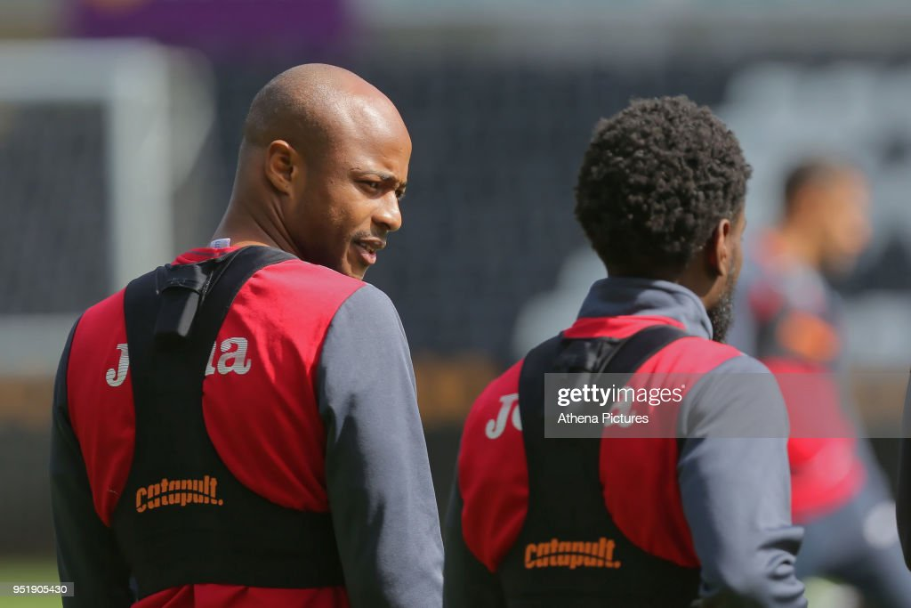 Andre Ayew speaks to Nathan Dyer during the Swansea City Training at The Liberty Stadium on April 26, 2018 in Swansea, Wales.