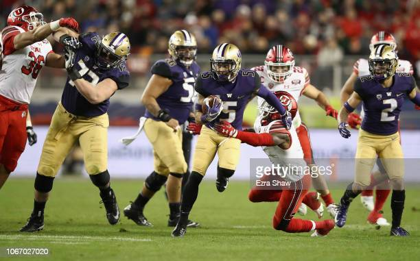 Andre Baccellia of the Washington Huskies breaks away from Jaylon Johnson of the Utah Utes during the Pac 12 Championship game at Levi's Stadium on...
