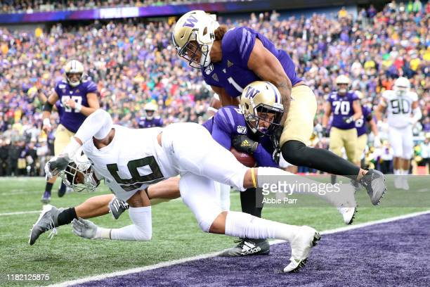 Andre Baccellia of the Washington Huskies scores a five yard touchdown against the Oregon Ducks in the second quarter during their game at Husky...