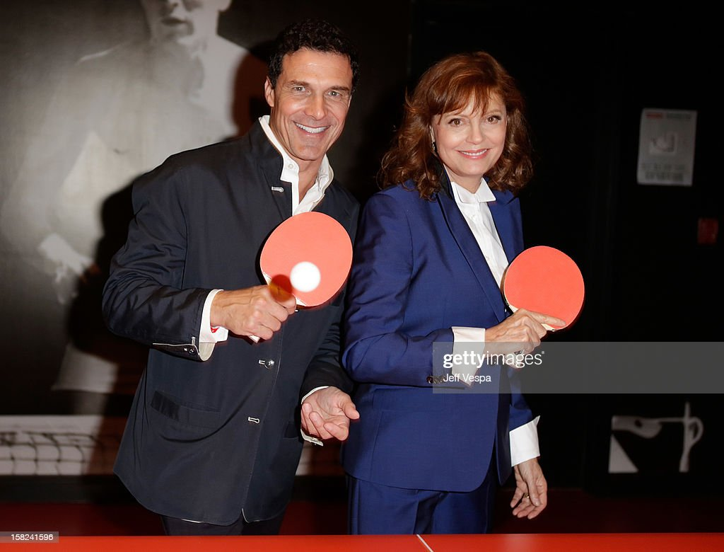 Andre Balazs (L) and actress Susan Sarandon attend SPiN Standard Ping Pong Social Club grand opening hosted by Susan Sarandon and Andre Balazs at The Standard, Downtown LA, on December 11, 2012 in Los Angeles, California.