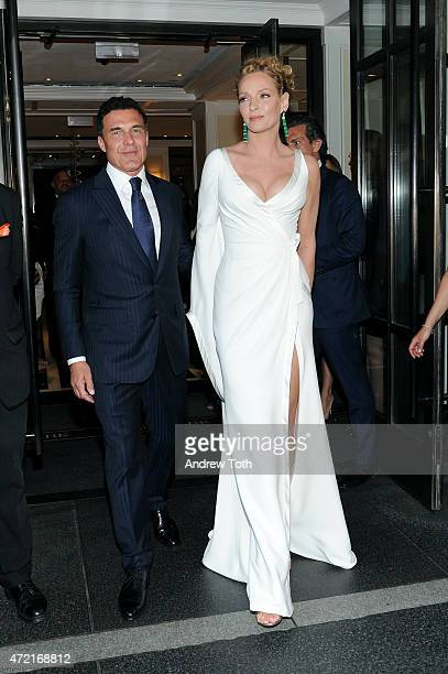 Andre Balazs and Uma Thurman depart The Mark Hotel for the Met Gala at the Metropolitan Museum of Art on May 4 2015 in New York City